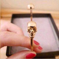 dual skull cuff bracelet rose gold